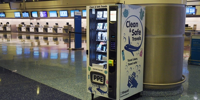A personal protective equipment vending machine is set up in the Terminal 1 ticketing area. (Ethan Miller/Getty Images)