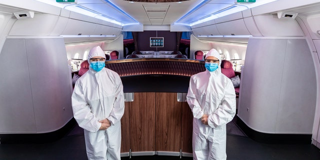 Qatar Airways has announced that cabin crew employees will begin wearing hazmat-style suits, pictured, during flights to enhance onboard safety.