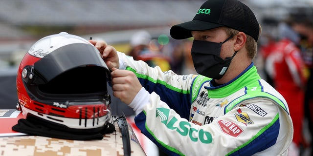 Tyler Reddick, driver of the #8 Alsco Uniforms Chevrolet, stands on the grid during qualifying for the NASCAR Cup Series Coca-Cola 600 at Charlotte Motor Speedway on May 24, 2020 in Concord, North Carolina. (Photo by Chris Graythen/Getty Images)