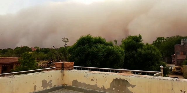 A video grab from the frightening moment a giant sandstorm looms and slowly engulfs the city of Rajasthan, northern India. May 17 2020.