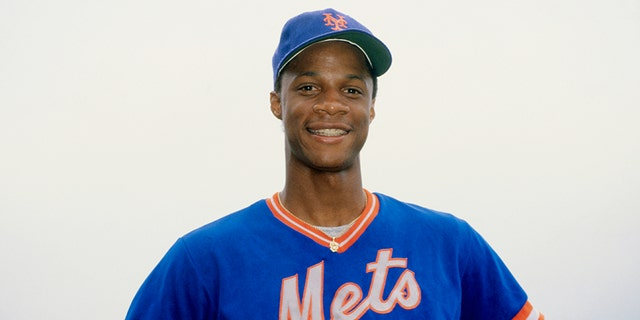 New York Mets rookie outfielder Darryl Strawberry smiles in uniform. Later in his career he also played for the New York Yankees.