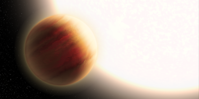 This is an artist's illustration of the super-hot exoplanet WASP-79b, located 780 light-years away. The planet orbits precariously close to a star that is much hotter than our Sun. The planet is larger than Jupiter, and its very deep, hazy atmosphere sizzles at 3,000 degrees Fahrenheit — the temperature of molten glass. The Hubble Space Telescope and other observatories measured how starlight is filtered through the planet's atmosphere, allowing for its chemical composition to be analyzed. Hubble has detected the presence of water vapor. (Credits: NASA, ESA and L. Hustak (STScI))