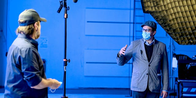 During shoots in the future, all personnel will be likely be required to wear masks on set.