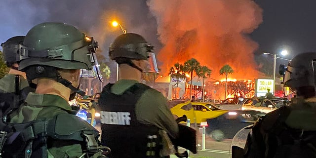 A Champ's Sports store in Tampa was burned to the ground as protests turned violent Saturday night.
