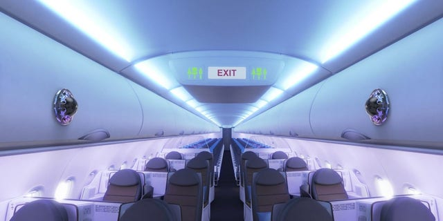 In an image, Airbus shows sensing devices affixed to overhead bins inside an airplane. (Credit: Airbus)