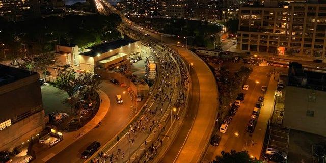 Protestors coming off the Brooklyn Bridge from Manhattan.