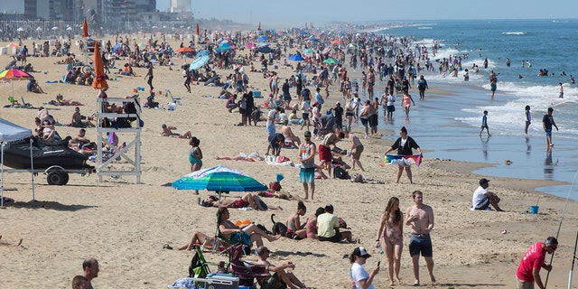 Warm weather draws crowds to the oceanfront, May 16 in Virginia Beach, Va. (Kaitlin McKeown/The Daily Press via AP)