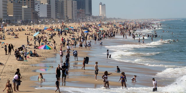 Warm weather draws crowds to the oceanfront May 16 in Virginia Beach, Va. (Kaitlin McKeown/The Daily Press via AP)