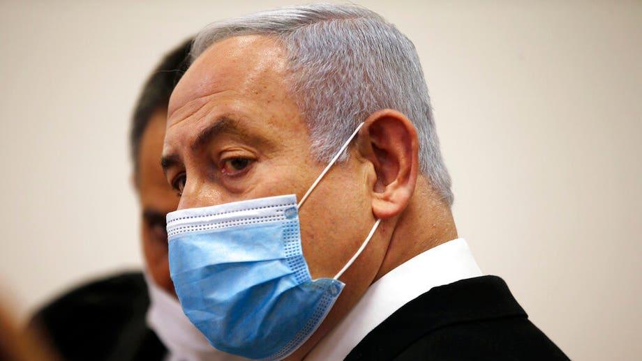 Benjamin Netanyahu's corruption trial starts as Israeli PM hits back at justice system