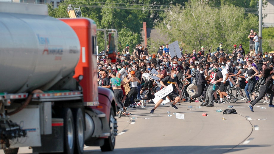 Semitrailer speeds toward crowd of George Floyd protesters on Minneapolis bridge; driver arrested