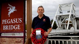 One man lays wreaths in Normandy on unusual D-Day hit by coronavirus