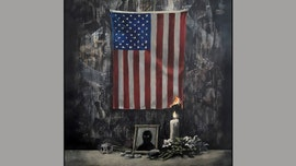 Latest Banksy art shows burning American flag in Floyd tribute