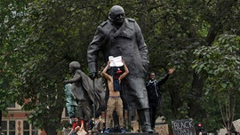 London statue of Winston Churchill vandalized on D-Day amid protests