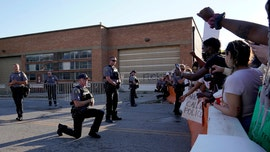 Oklahoma deputies take a knee in solidarity, hug protesters demanding justice for George Floyd