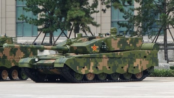Chinese armored vehicles conduct massive attack drills