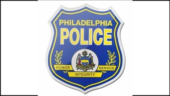 Philadelphia police arrest 2 men suspected of setting cruiser on fire
