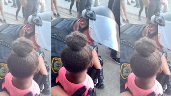 Houston cop seen comforting 5-year-old girl at George Floyd protest who asked: 'Are you gonna shoot us?'