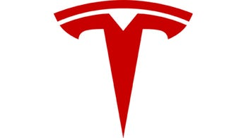 Here's what the Tesla logo really means