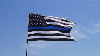 "Florida high school bans football team's police flag after critics deem it ""openly racist"""