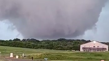 Wall cloud spotted in Wisconsin as tornado warning issued, flash-flooding spurs rescues