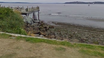 Seattle-area man, 62, held after discovery of couple's remains inside suitcase: authorities