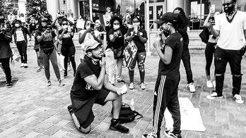 North Carolina couple gets engaged at Black Lives Matter protest: 'Black love matters'