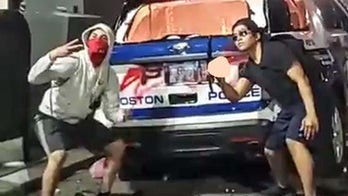 FBI, Boston authorities searching for men seen posing in front of burned-out police cruiser