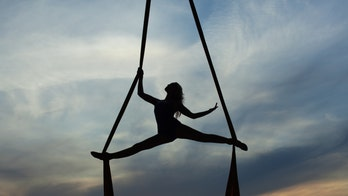 Aerial acrobat practices crazy tricks at home during pandemic