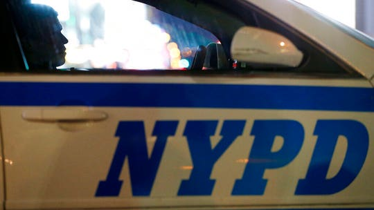 NYPD officer seen shoving woman, 20, to ground during BLM protest charged with assault