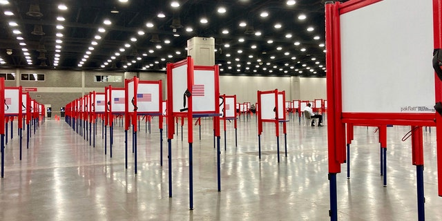 Voting stations are set up for the primary election at the Kentucky Exposition Center, Monday, June 22, 2020, in Louisville, Ky. (AP Photo/Piper Blackburn)