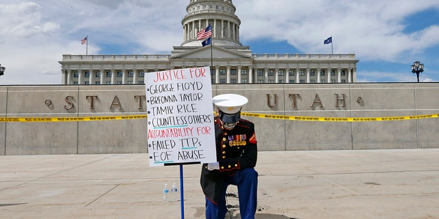 Retired Marine Todd Winn protests in front of the Utah State Capitol Friday, June 5, 2020, in Salt Lake City. (AP Photo/Rick Bowmer)