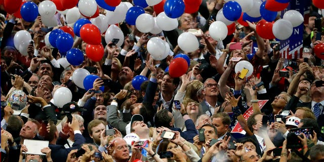 Confetti and balloons fall during celebrations after Republican presidential candidate Donald Trump's acceptance speech on the final day of the Republican National Convention in Cleveland. July 21, 2016. (AP Photo/Matt Rourke, File)