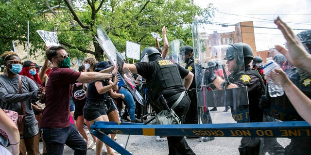 Protesters and police clash in Columbia, S.C., on Sunday. People protested against police brutality sparked by the death of George Floyd at the hands of police in Minneapolis on May 25. (Jason Lee/The Sun News via AP)
