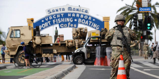 A member of the National Guard stands in front of the Santa Monica Pier building Monday, June 1, 2020, in Santa Monica, Calif.