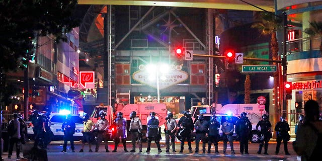 Police stand in formation at the entrance to Fremont Street Experience Monday, June 1, 2020, in downtown Las Vegas. Police were present for a community protest over the death of George Floyd, a Minneapolis man who died in police custody on Memorial Day.