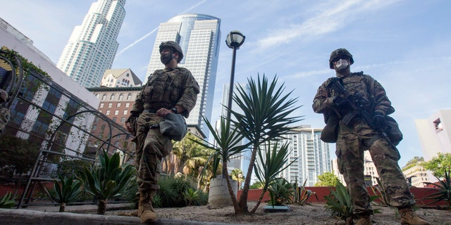 Members of the California National Guard patrol in Los Angeles on May 31, 2020.  (AP Photo/Ringo H.W. Chiu, File)