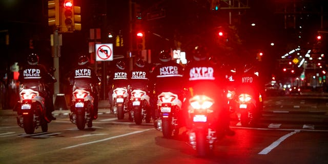 Police ride their scooters through the East Village neighborhood of New York, patrolling the streets during an imposed curfew on Tuesday, June 2, 2020, in New York. Thousands of demonstrators protesting the death of George Floyd remained on New York City streets on Tuesday after an 8 p.m. curfew put in place by officials struggling to stanch destruction and growing complaints that the nation's biggest city was reeling out of control night after night. (AP Photo/Wong Maye-E)