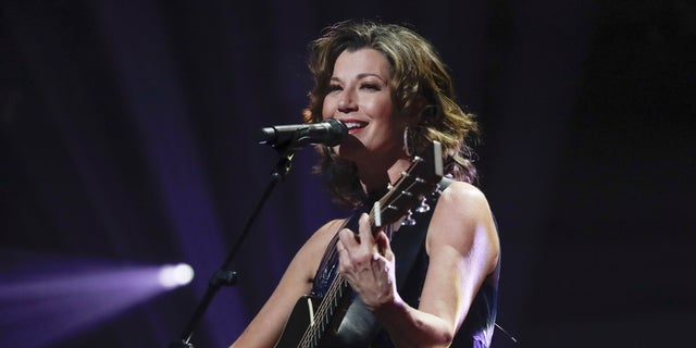 In this Oct. 15, 2019, photo, singer Amy Grant performs during the Dove Awards in Nashville, Tenn.聽