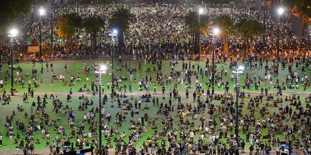 In this aerial view, participants gather for a vigil to remember the victims of the 1989 Tiananmen Square Massacre, despite permission for it being officially denied, at Victoria Park in Causeway Bay, Hong Kong, Thursday, June 4, 2020. (AP Photo/Vincent Yu)