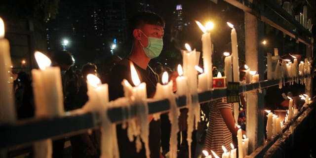 Participants light candles during a vigil for the victims of the 1989 Tiananmen Square Massacre at Victoria Park in Causeway Bay, Hong Kong, Thursday, June 4, 2020, despite applications for it being officially denied. (AP Photo/Kin Cheung)