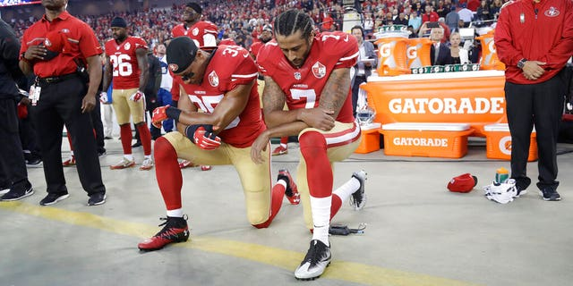 FILE - In this Sept. 12, 2016, file photo, San Francisco 49ers safety Eric Reid (35) and quarterback Colin Kaepernick (7) kneel during the national anthem before an NFL football game against the Los Angeles Rams in Santa Clara, Calif. (AP Photo/Marcio Jose Sanchez, File)