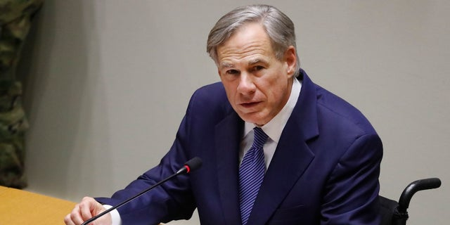 Texas Gov. Greg Abbott speaks at a news conference at city hall in Dallas. Officials in the San Antonio area issued an executive order Wednesday requiring the wearing of face masks when social distancing is not practical. (AP Photo/LM Otero, File)