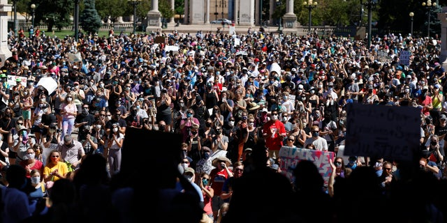 Demonstrators crowd into Civic Center Park in Denver, June 7, 2020. (Associated Press)