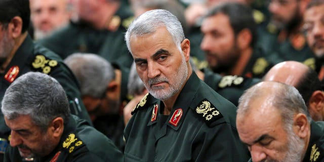 Revolutionary Guard Gen. Qassem Soleimani, center, attends a meeting in Tehran, Iran, in September 2016. (Office of the Iranian Supreme Leader via AP, File)