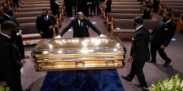 The casket of George Floyd placed in the chapel for the funeral service at the Fountain of Praise church Tuesday in Houston. (AP Photo/David J. Phillip, Pool)