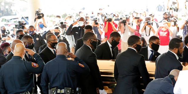 Texas Southern University police saluting as family and guests arrived for George Floyd's funeral service. (AP Photo/Eric Gay)