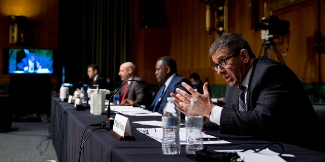 Secret Service Assistant Director Michael D'Ambrosio, right, accompanied by from left, Justice Department Associate Deputy Attorney General William Hughes, Justice Department U.S. Attorney Craig Carpenito, and FBI Criminal Investigative Division Assistant Director Calvin A. Shivers, speaks at a Senate Judiciary Committee hearing on Capitol Hill in Washington, Tuesday, June 9, 2020. (Associated Press)
