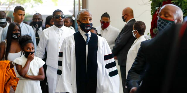 Rev. Al Sharpton entering the church for the funeral for George Floyd on Tuesday at The Fountain of Praise church in Houston. (Godofredo A. Vásquez/Houston Chronicle via AP, Pool)