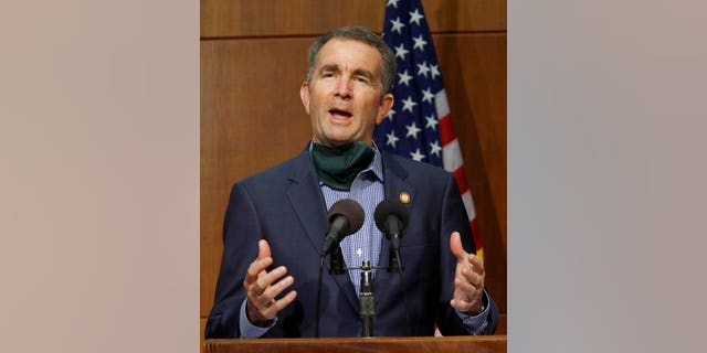 Virginia Gov. Ralph Northam answers a question during a press briefing inside the Patrick Henry Building in Richmond, Va. (Bob Brown/Richmond Times-Dispatch via AP)
