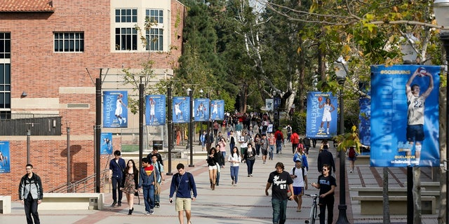 Students walk on the University of California, Los Angeles campus. The University of California Board of Regents voted Monday to support a statewide measure to repeal a ban on race and gender-based considerations in college admissions. (AP Photo/Damian Dovarganes, File)